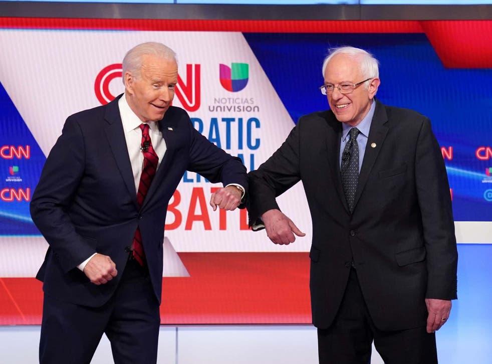Joe Biden and Bernie Sanders greet with the coronavirus 'handshake' (Re