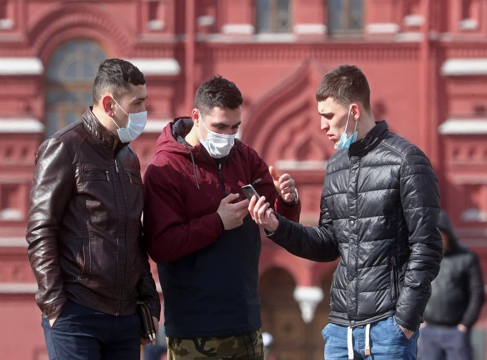 Moscovites wearing face masks in Red Square: the country has seen relatively few cases of Covid-19 so far