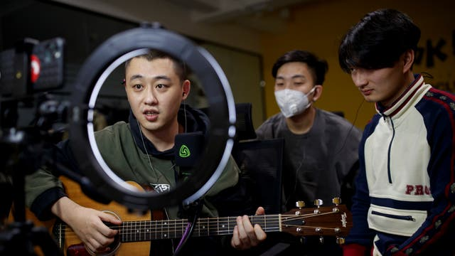 Chinese group The 2econd perform for their fans during a live-streaming session broadcast on the video sharing website Bilibili, at an office in Beijing
