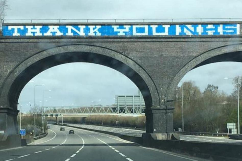 NHS thank you message painted over M25 graffiti