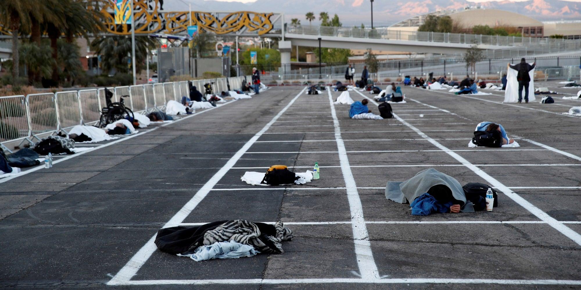 Homeless people in Las Vegas sleep 6 feet apart in parking lot as thousands of hotel rooms sit empty