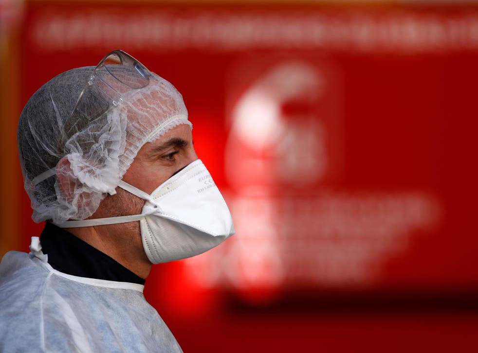 A member of an ambulance crew during a rescue operation in Strasbourg as the spread of the coronavirus disease (Covid-19) continues in France, 27 March, 2020