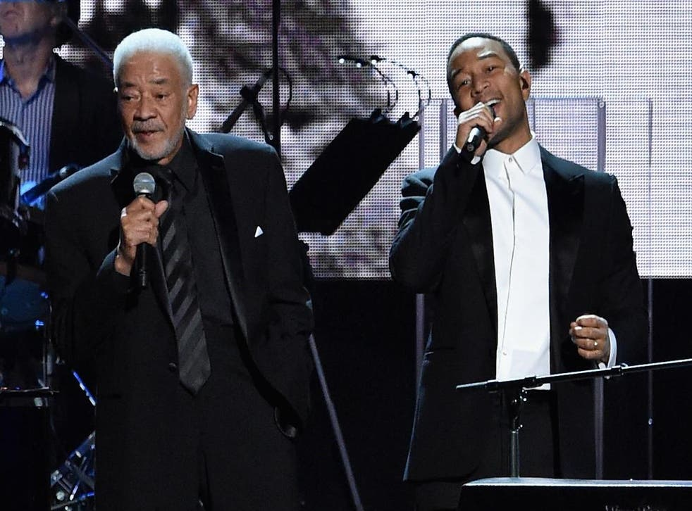 Bill Withers and John Legend perform during the 30th Annual Rock And Roll Hall Of Fame Induction Ceremony on 18 April 2015 in Cleveland, Ohio.