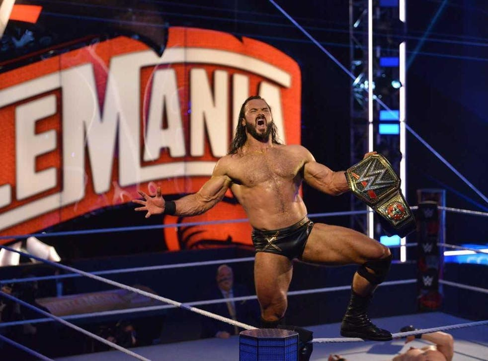 Drew McIntyre celebrates winning the title