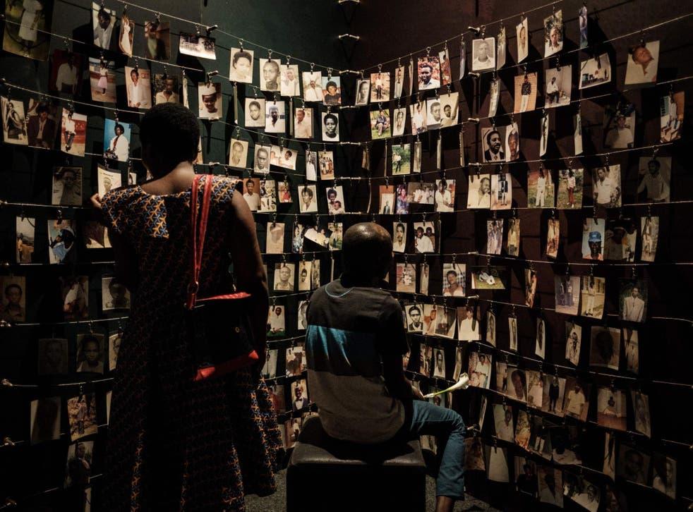 Visitors look at victims' portraits at the Kigali Genocide Memorial in Rwanda