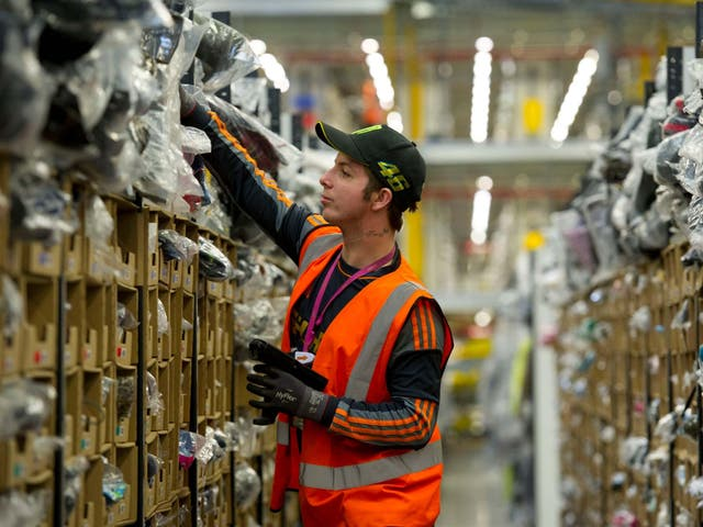 A worker at an Amazon fulfilment centre