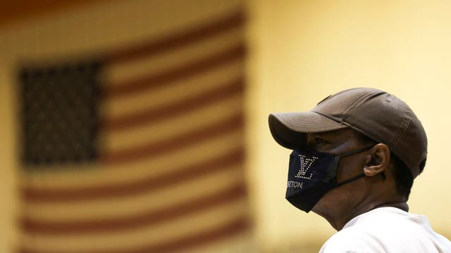 Steve Merriweather waits to vote inside Riverside University High School during the Wisconsin primary