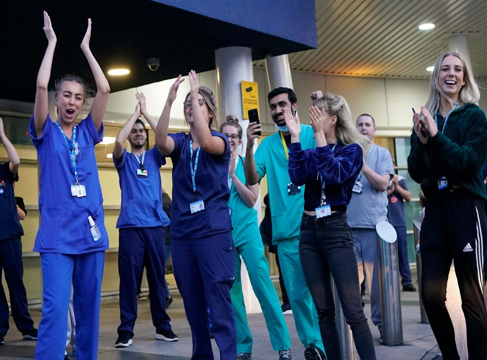 <p>NHS staff at the entrance of the Royal Liverpool Hospital yesterday</p>