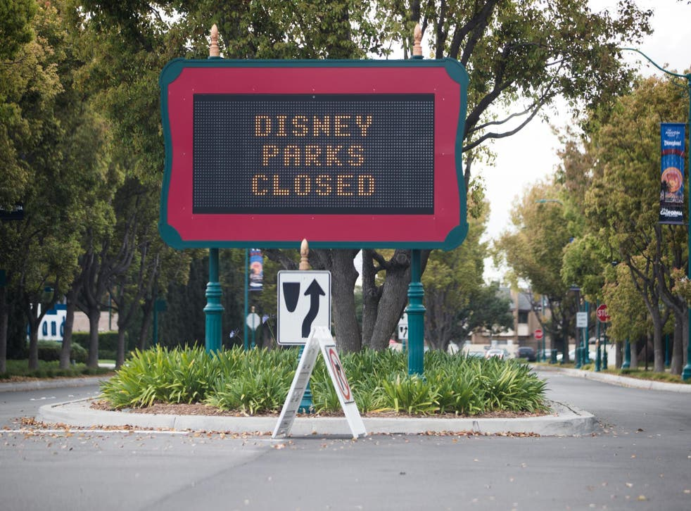 A sign announces the closure of Disney theme parks in Anaheim, California, on 14 March 2020.