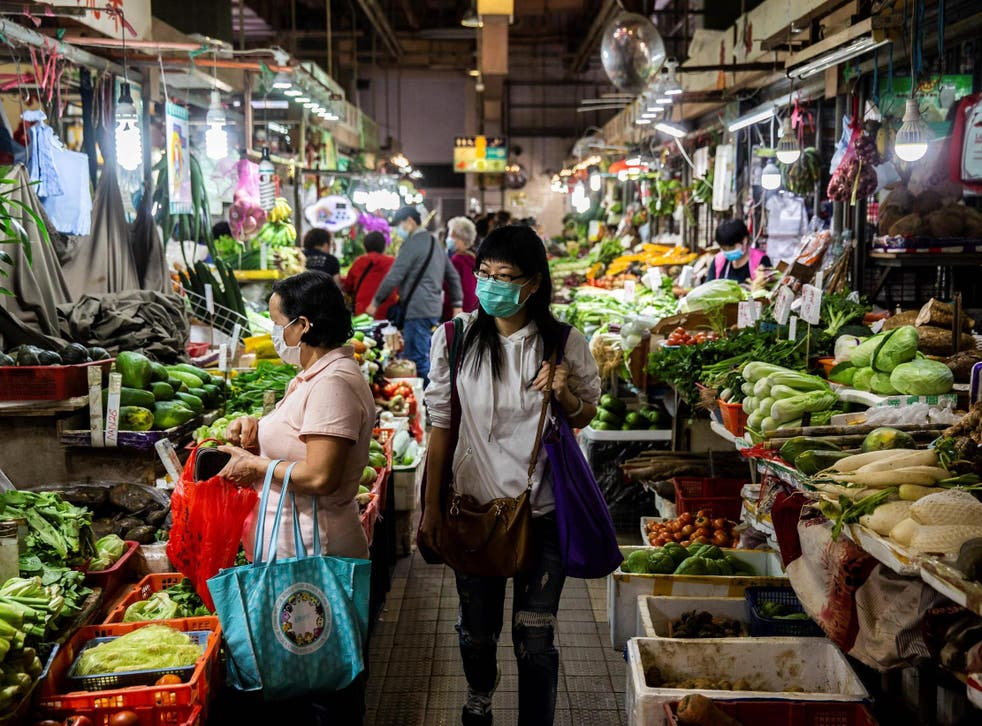Shoppers at a wet market in Hong Kong on February 25, 2020