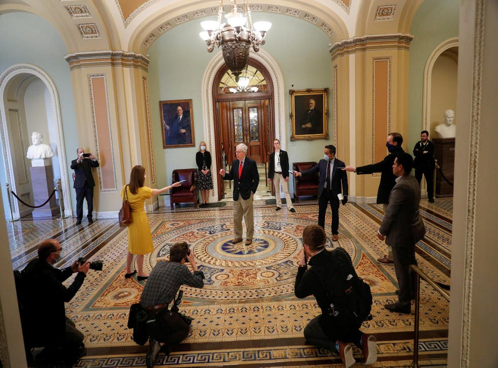 Senate Majority Leader McConnell speaks to members of the news media after departing from the Senate Chamber floor on Capitol Hill in Washington
