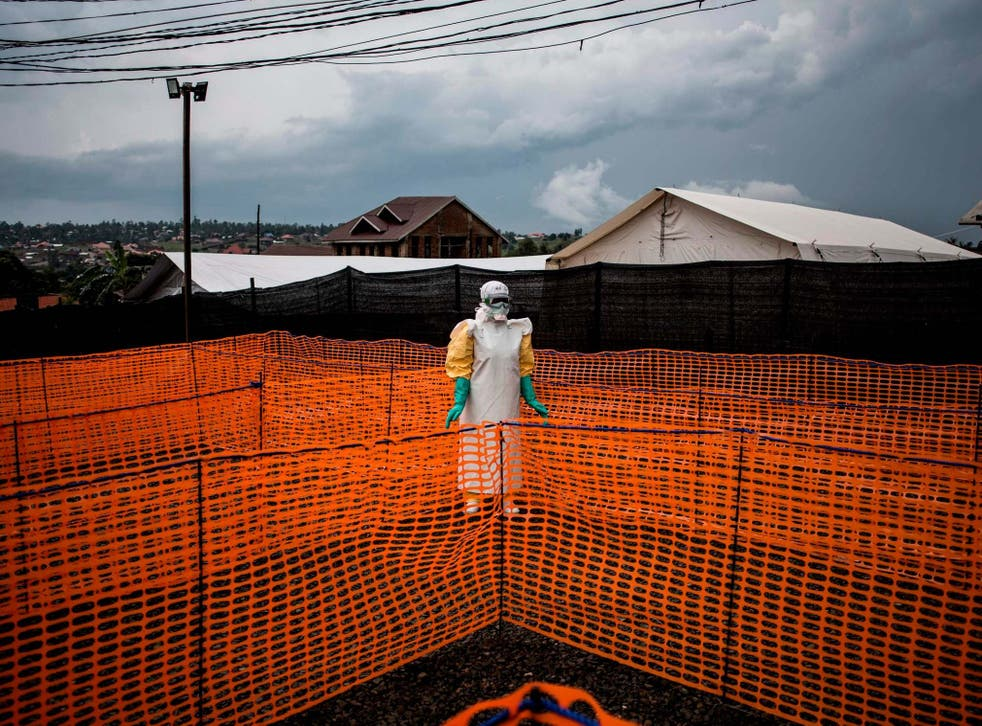 A health worker waits to handle a new unconfirmed Ebola patient at a Medicines Sans Frontiers treatment centre in the Democratic Republic of the Congo in 2018