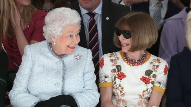 The Queen smiles while in conversation with <i>Vogue</i> editor Anna Wintour as the pair watch Richard Quinn's runway show at London Fashion Week, 20 February 2018