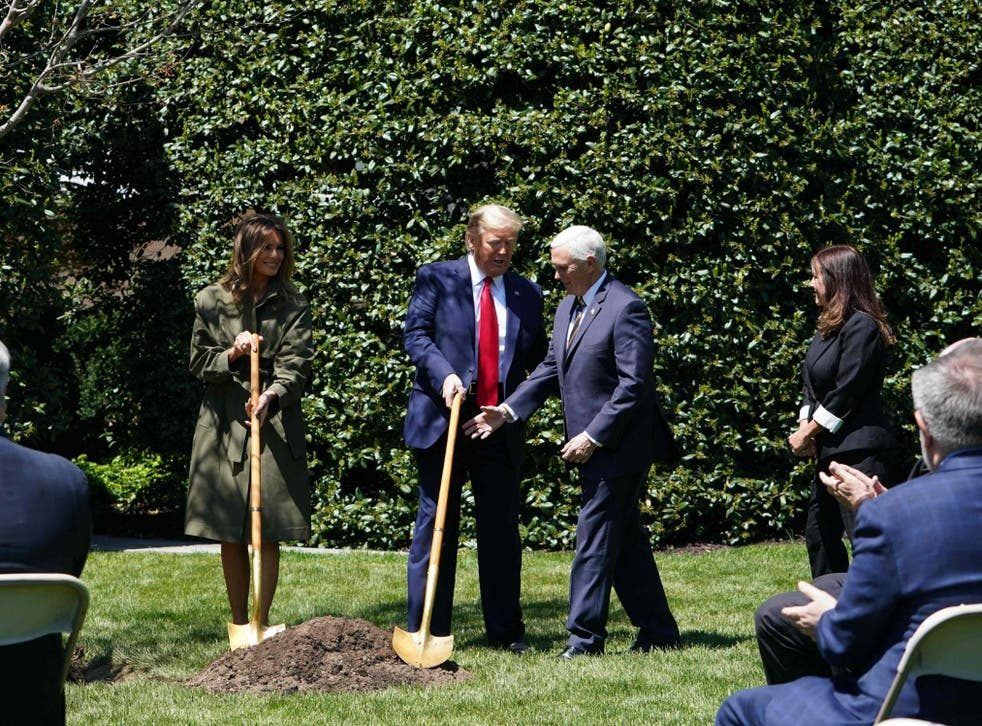 First Lady Melania Trump, President Trump, Vice President Mike Pence and Karen Pence participate in a tree planting ceremony to mark Earth Day and Arbor Day at the White House on 22 April 22, 2020