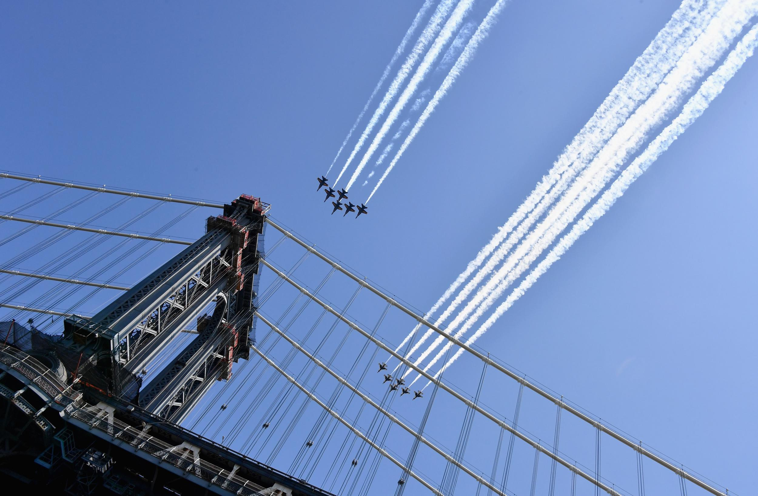 US Navy and Air Force planes fly over New York in tribute to health workers photo
