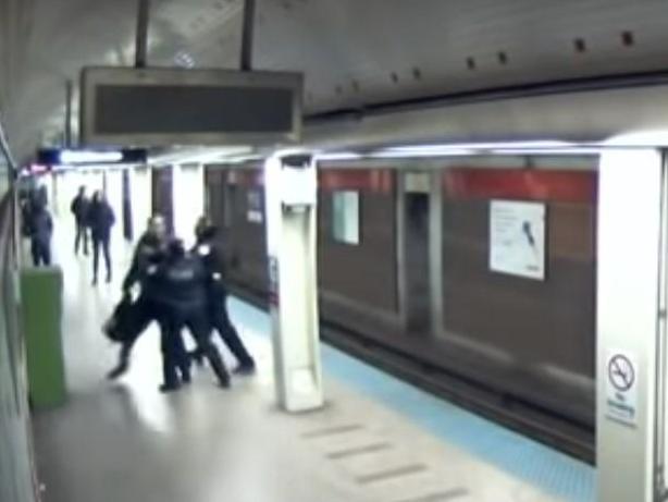 Footage shows Chicago police shooting unarmed man twice on subway escalator photo
