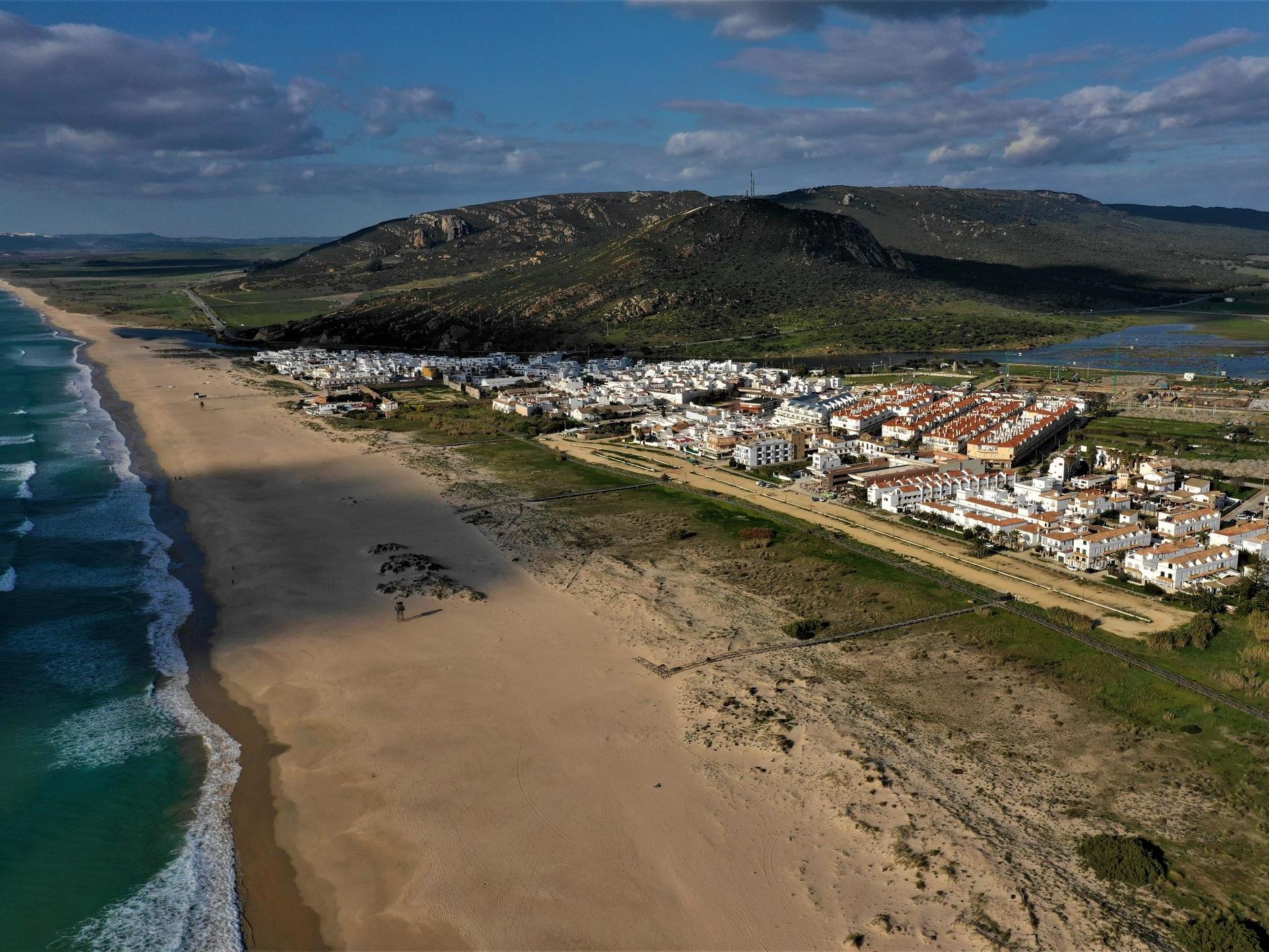 Coronavirus: Outrage after Spanish town sprays bleach on beach 'to protect children' photo