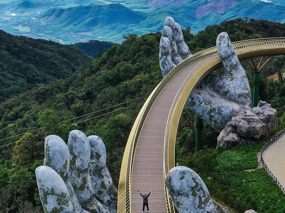 Image of golden Vietnamese bridge wins architecture photo prize photo