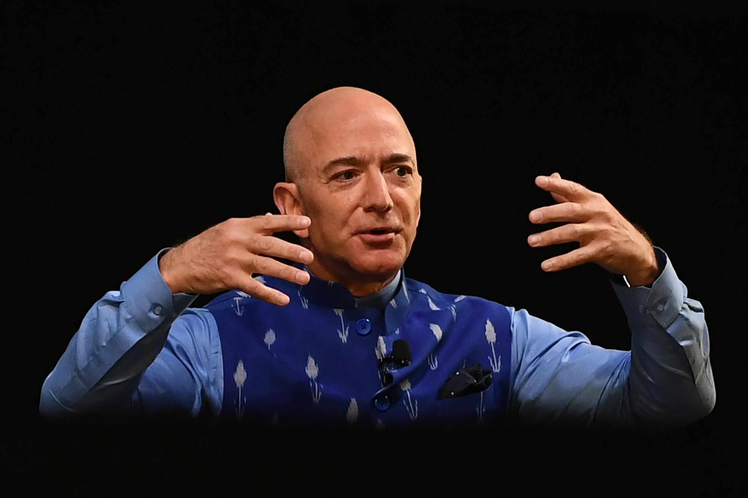 Amazon earnings: Jeff Bezos tells shareholders to 'take a seat' as profits hit by coronavirus  photo
