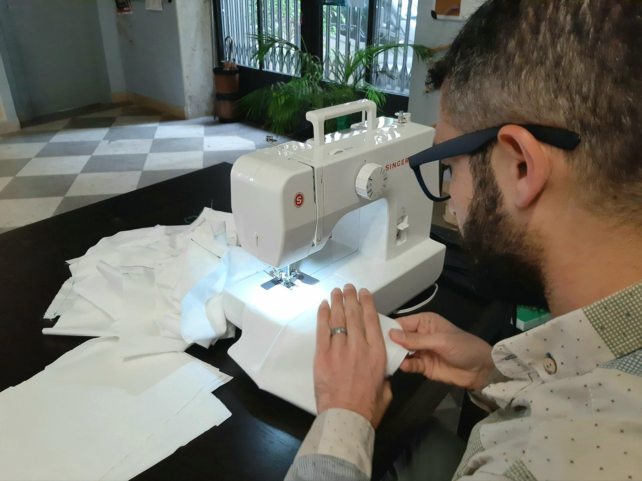 The Syrian refugee tailor sewing face masks for Italians photo