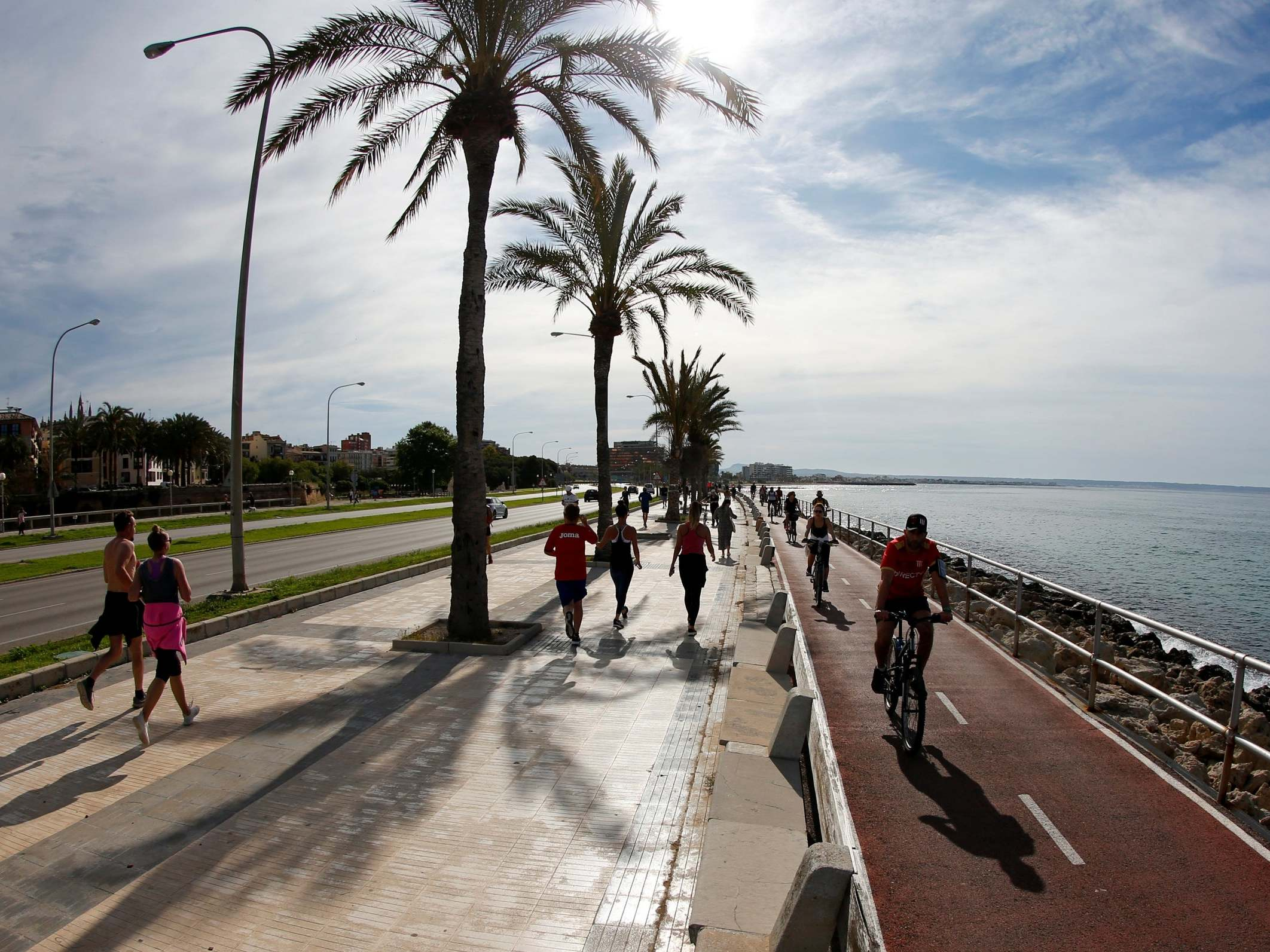 Coronavirus: Spain allows adults out to exercise for first time in seven weeks photo