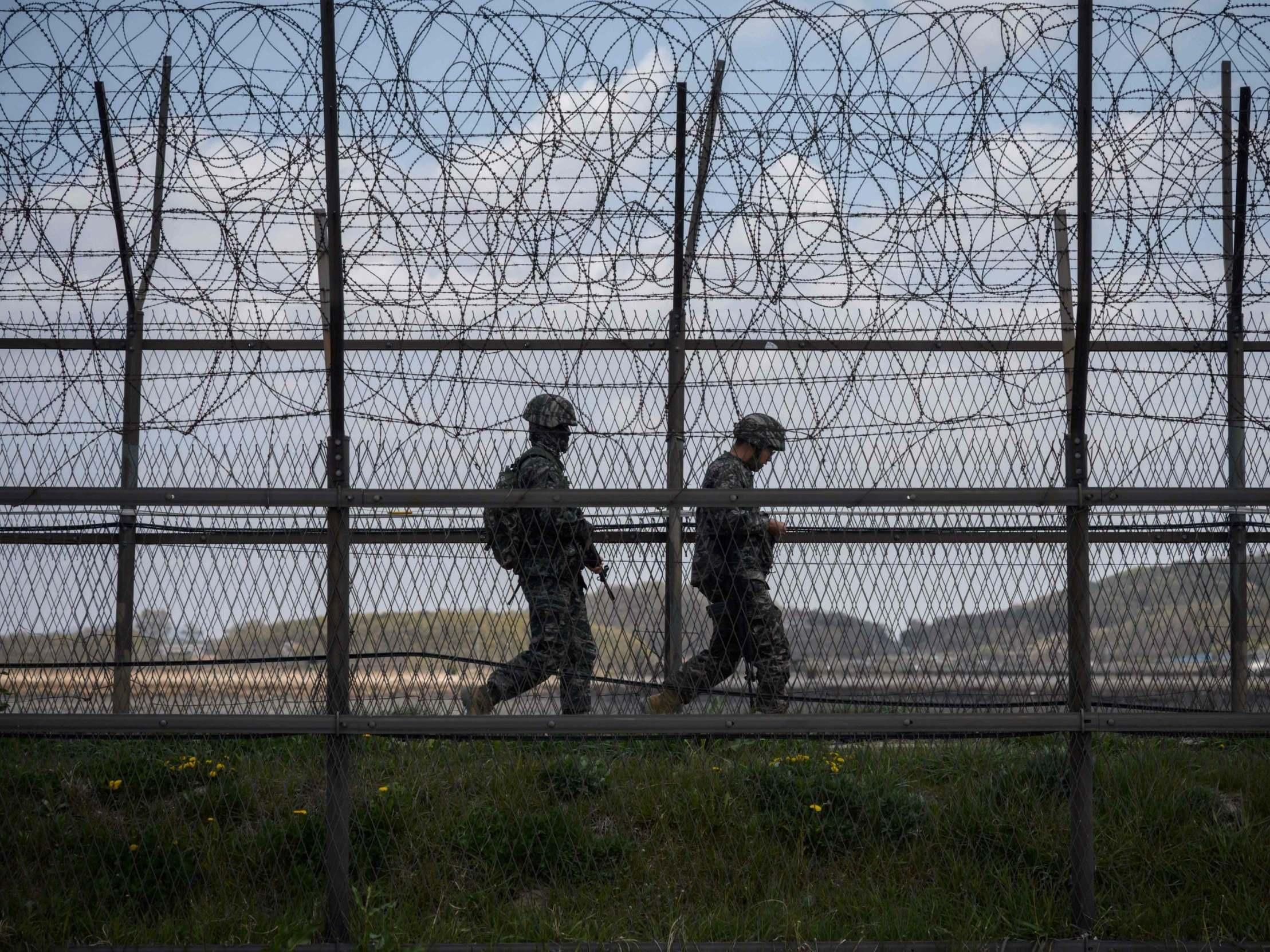 North and South Korea exchange gunfire across DMZ border area photo