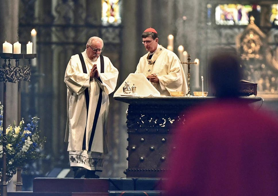A church service is held at Germany's Cologne Cathedral on 3 May 2020, after being closed for more than a month due to the coronavirus outbreak