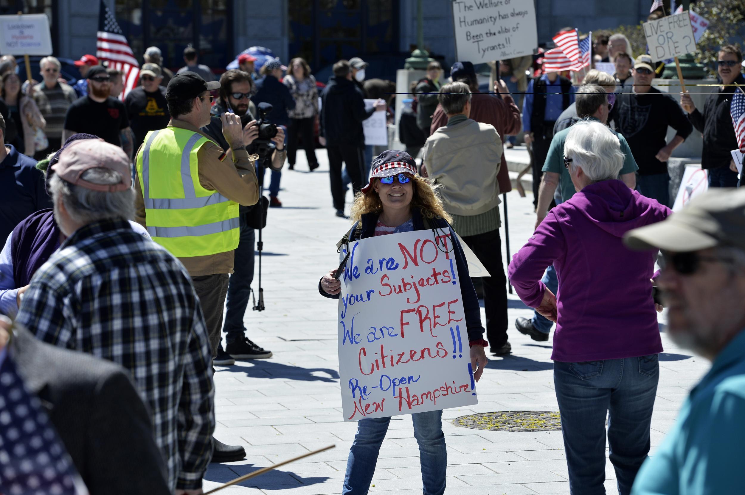 Anti-vaccination activists a growing force at US coronavirus protests photo
