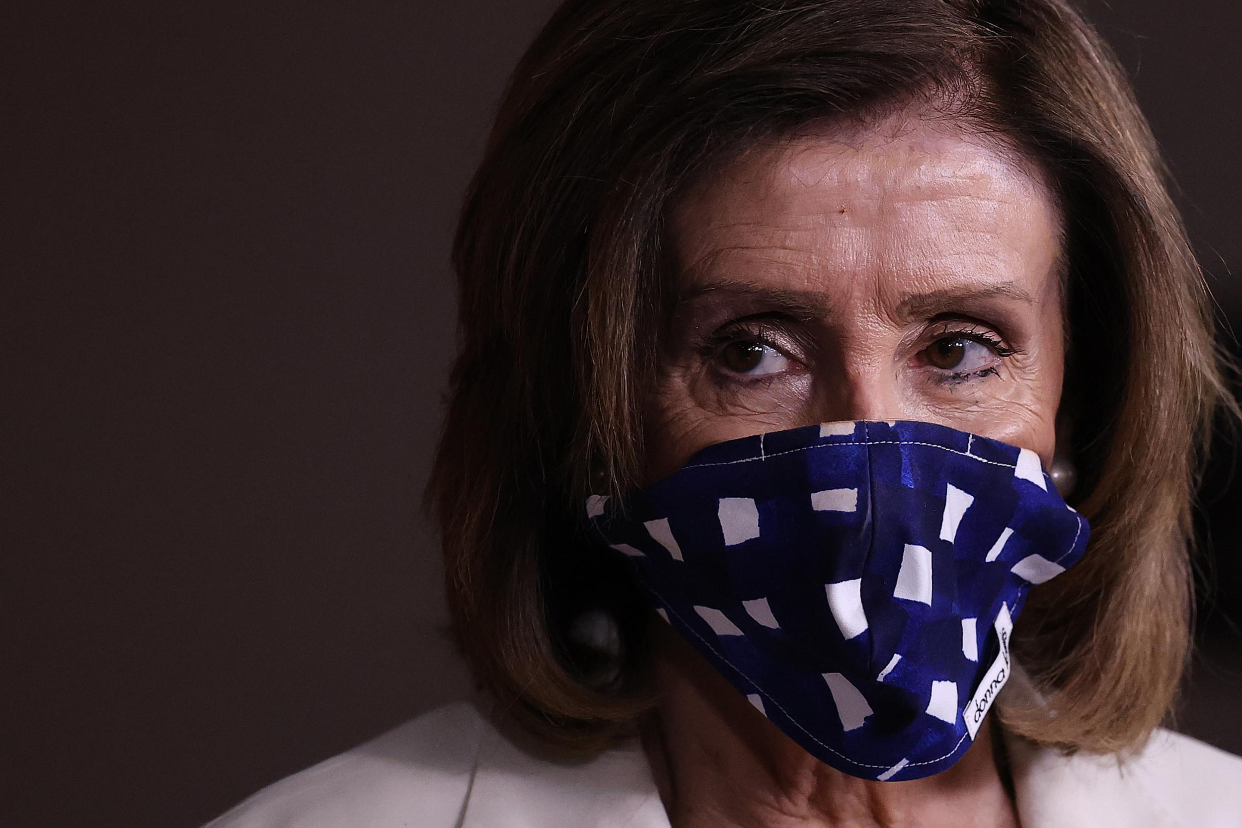 Nancy Pelosi calls GOP tax law a 'scam' as he defends $3trn Democratic coronavirus bill