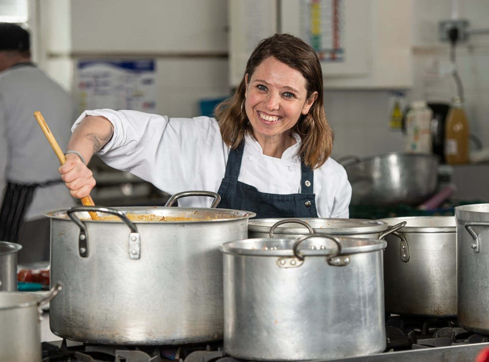 Chefs in Schools co-founder Nicole Pisani stirs up a free meal at Grasmere Primary School, Stoke Newington, north London