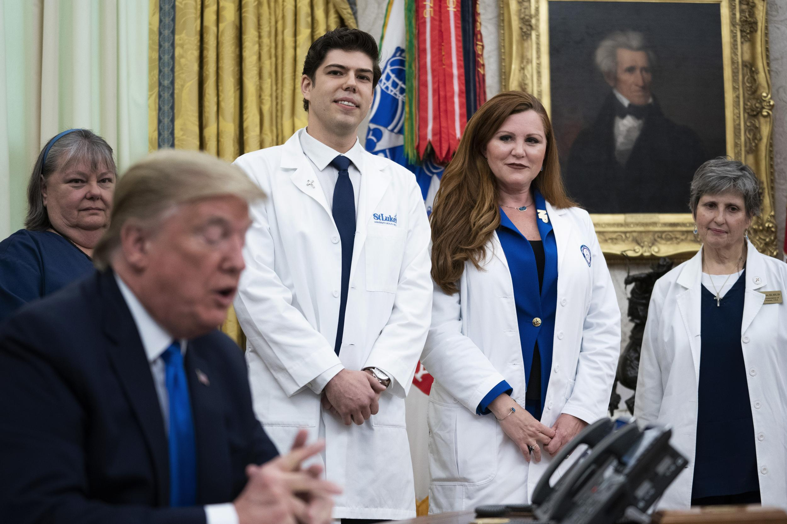Trump contradicts nurse describing 'sporadic' supply of protective gear despite wearing same N95 mask for 'a few weeks' thumbnail