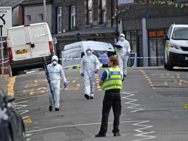 Forensic officers at the scene in Pen Y Graig in South Wales.