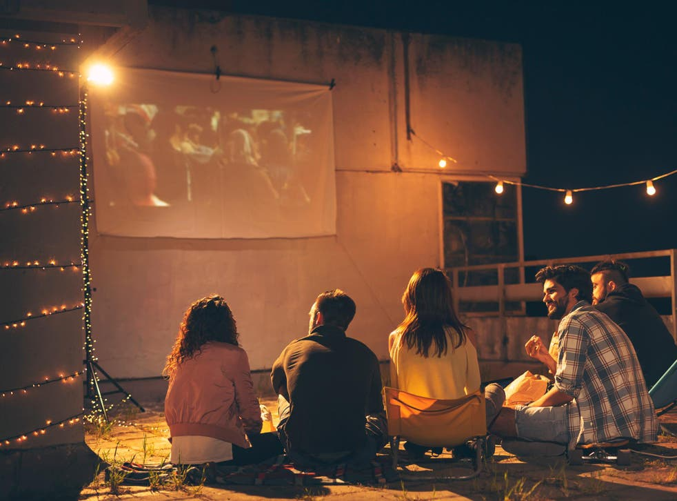With just a plain white bed sheet and a mini projector, you can create the experience at home