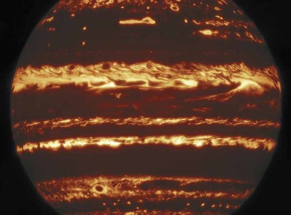 This image showing the entire disk of Jupiter in infrared light was compiled from a mosaic of nine separate pointings observed by the international Gemini Observatory