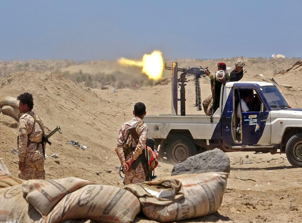 Fighters from the Southern Transitional Council fire towards the positions of Saudi-backed government forces in Abyan