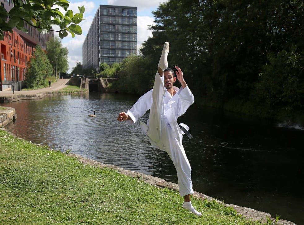 <p>Team GB's karate athlete Jordan Thomas trains outside his apartment in Manchester</p>