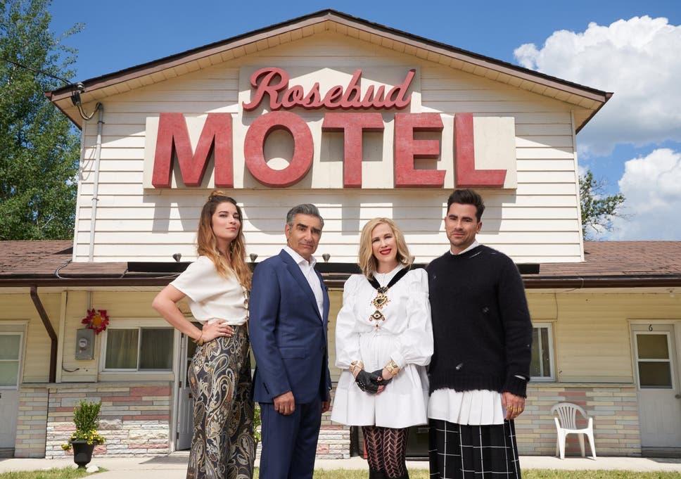 The Rose Family standing in front of the Rosebud Motel.