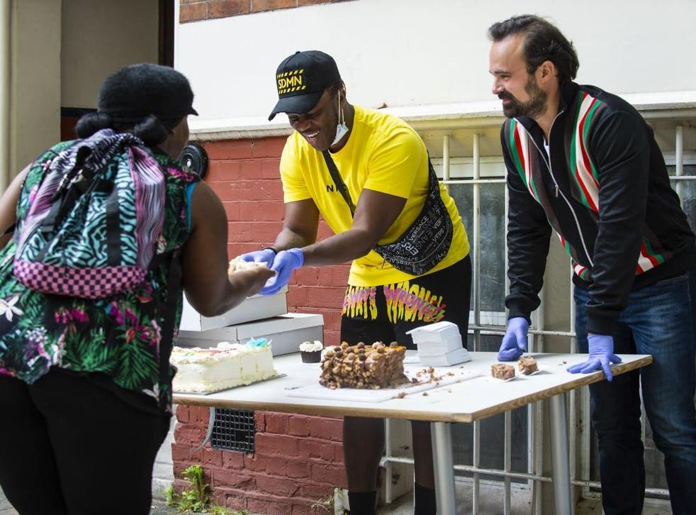 <p>Evgeny Lebedev, proprietor of The Independent and Evening Standard, joins rapper KSI to help hand out food</p>