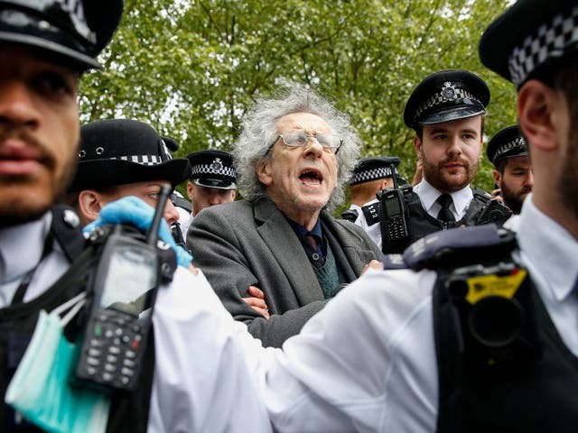 Police officers apprehend Piers Corbyn, Jeremy Corbyn's brother, during a demonstration against the coronavirus lockdown in Hyde Park on 16 May