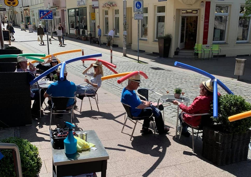 German cafe gives customers 'pool noodle' hats to ensure social ...