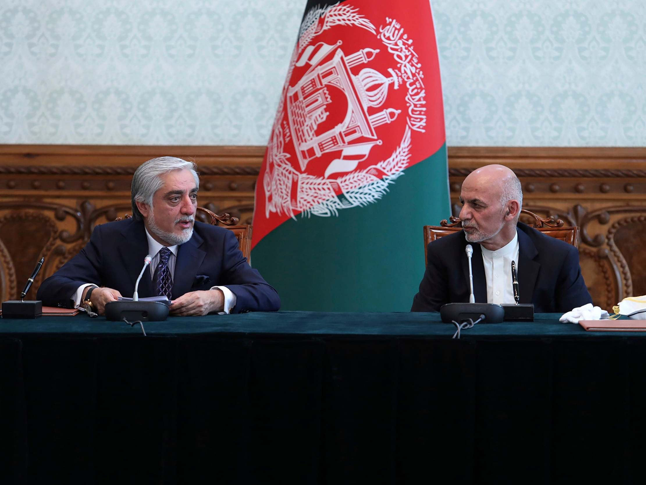 Afghan president and rival strike power-sharing deal after months-long stand-off