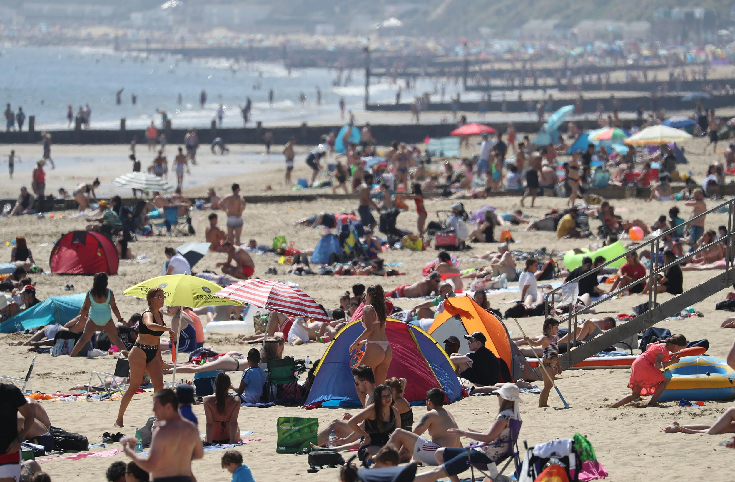 UK weather: Crowds hit beaches despite lockdown as Met Office confirms hottest day of the year