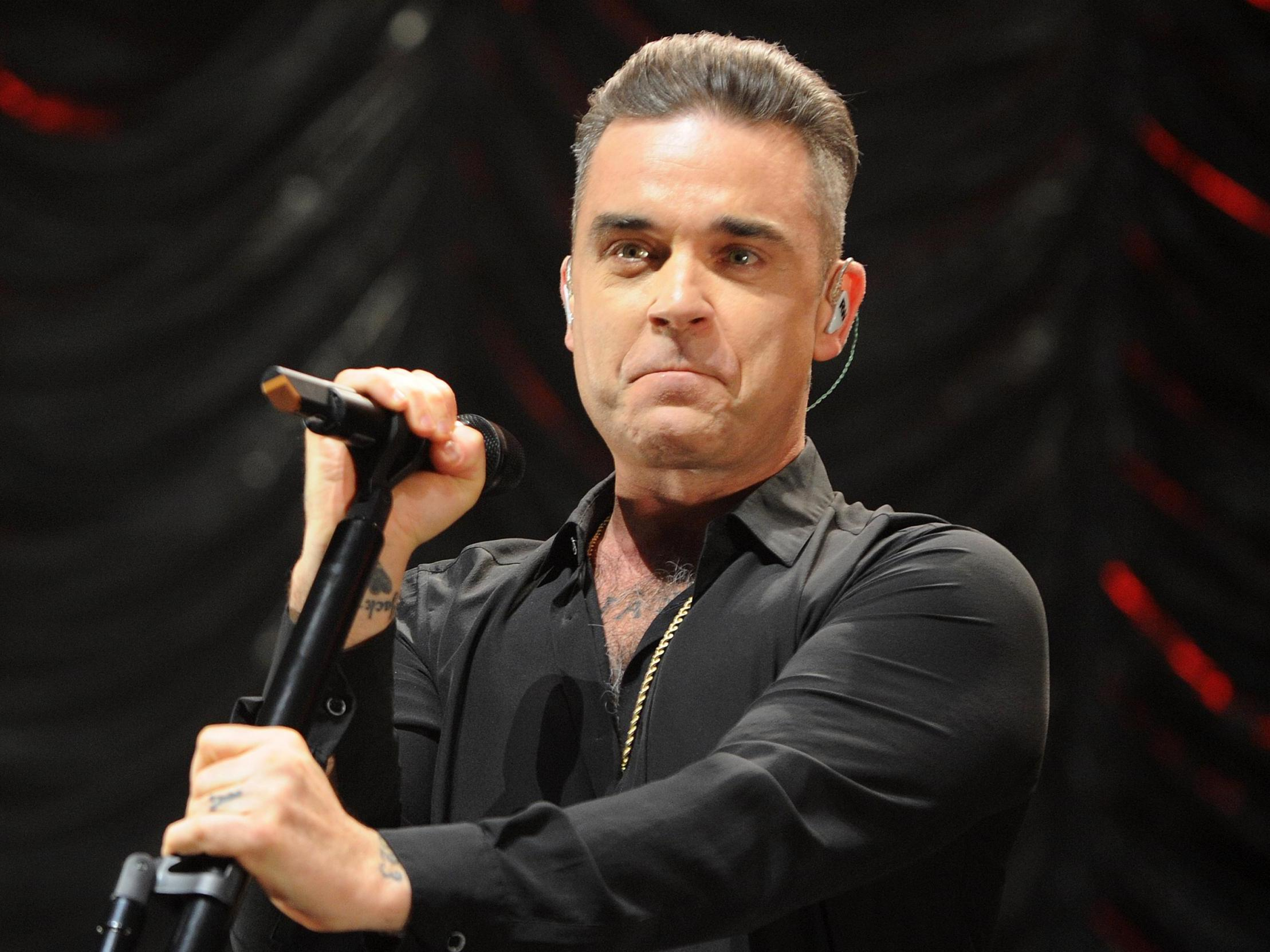 Robbie Williams reveals his father has Parkinson's disease