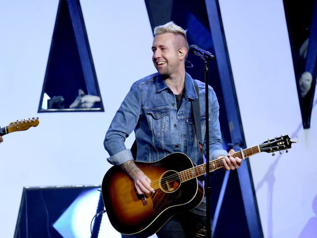 NASHVILLE, TN - MAY 28: Jon Steingard of Hawk Nelson performs onstage at the 5th Annual KLOVE Fan Awards at The Grand Ole Opry on May 28, 2017 in Nashville, Tennessee.