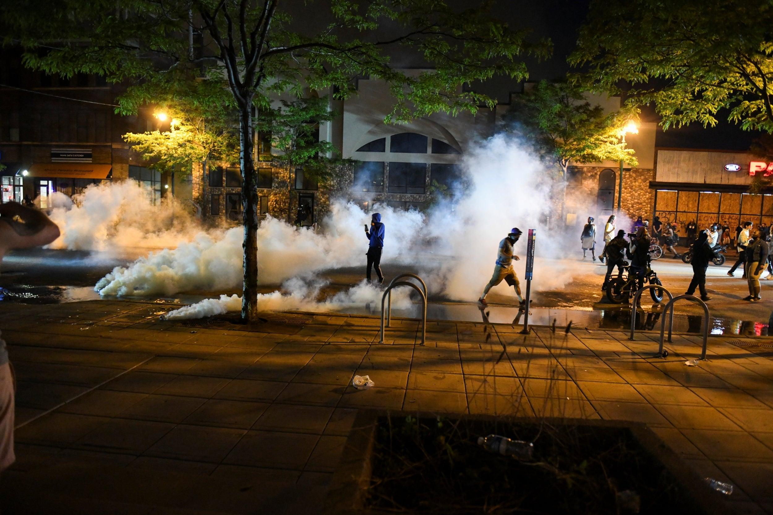 George Floyd protests: One dead in shooting amid riots and looting as Minneapolis mayor appeals for calm