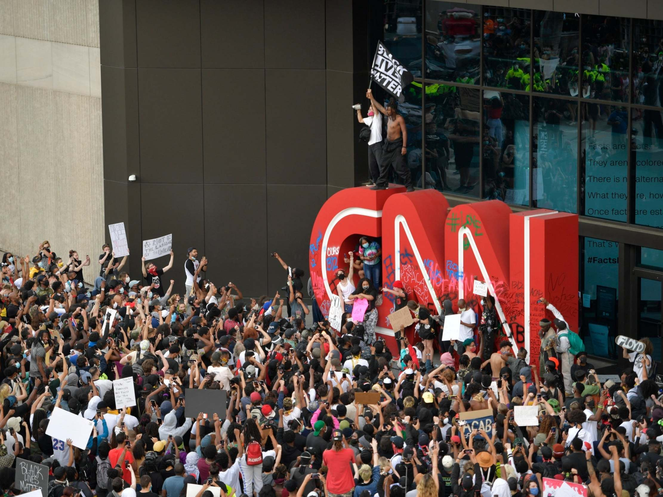 George Floyd: Atlanta protesters attack CNN building as mayor says 'go home'