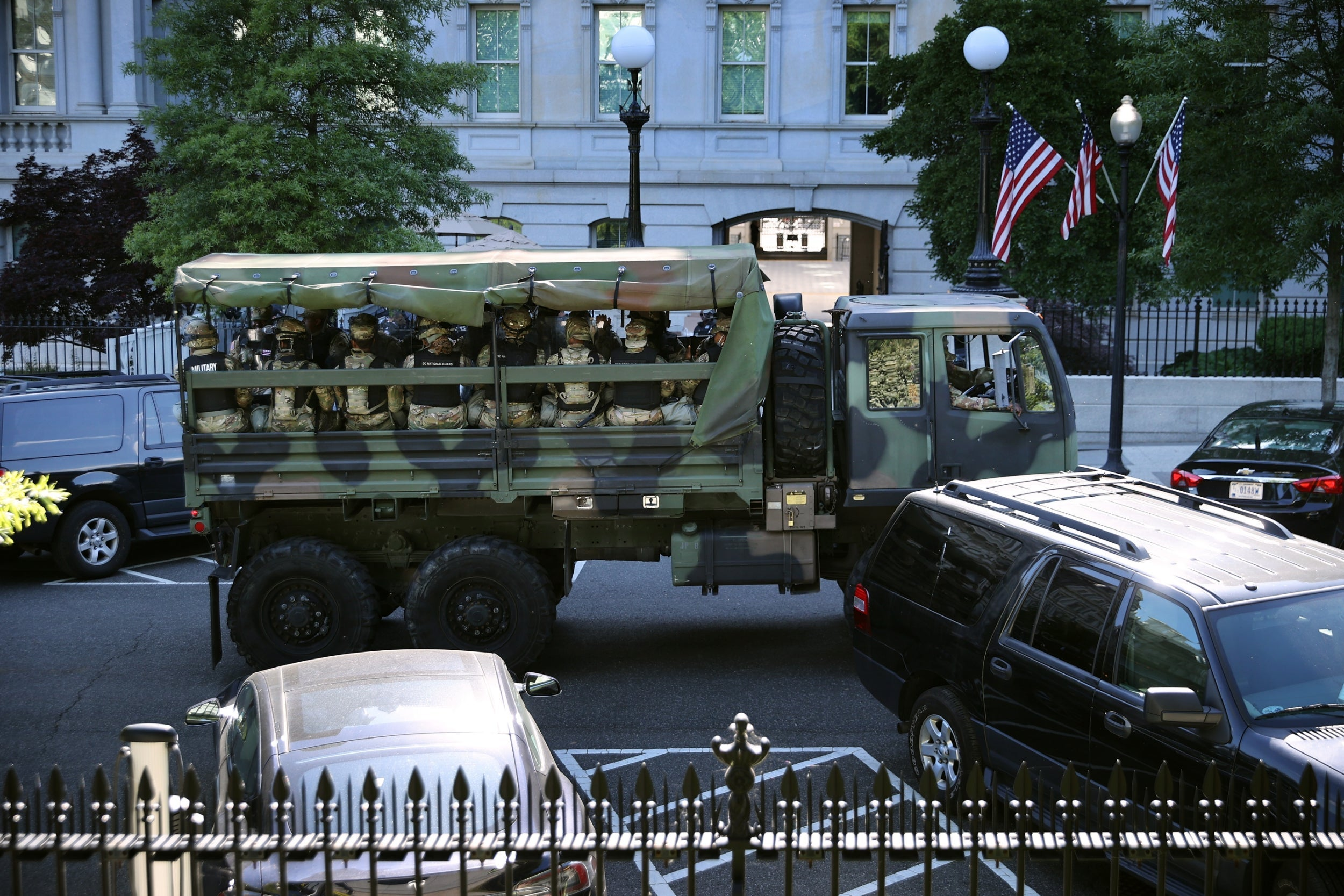Military trucks seen arriving at White House after Trump tells governors to be tough on protests