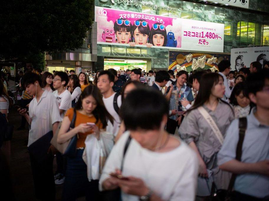 City in Japan proposes new law banning phone use while walking