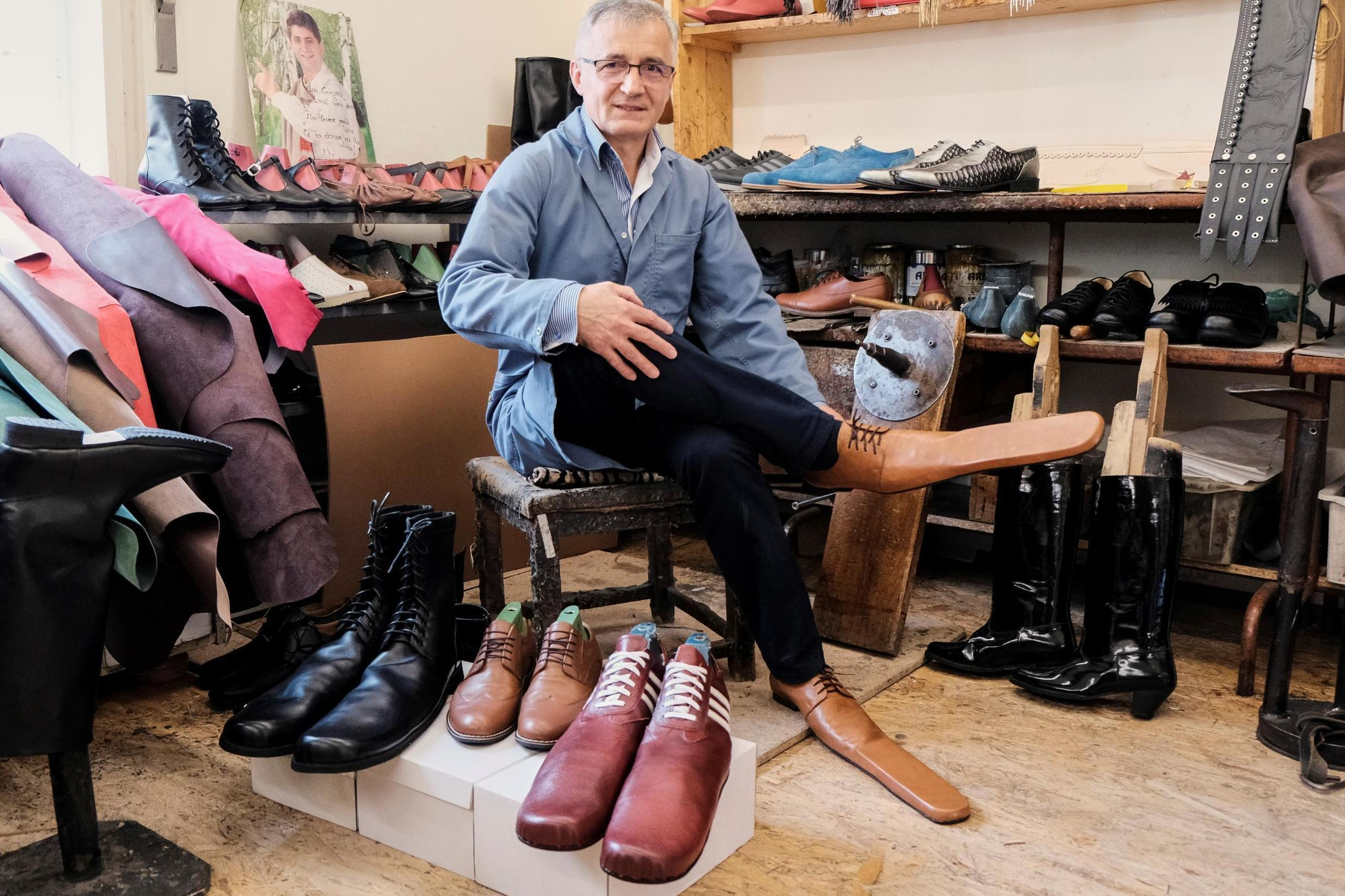Shoemaker makes size 75 shoes for social distancing