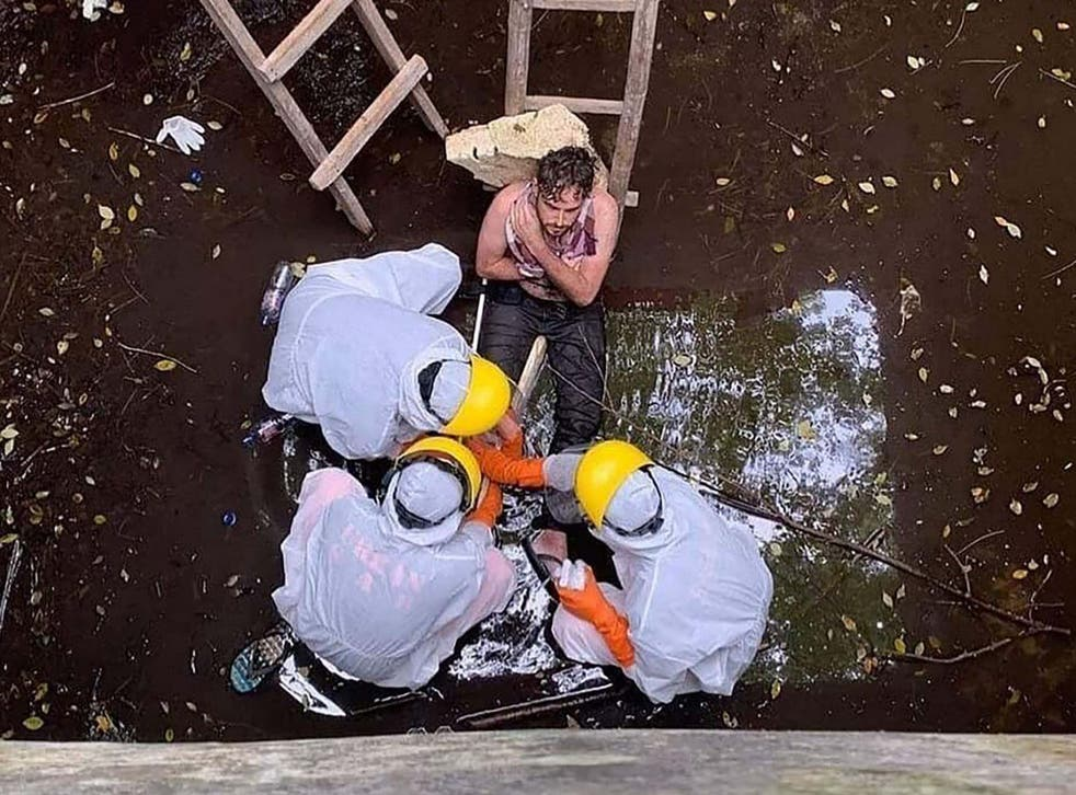 Members of an Indonesian search and rescue team save British national Jacob Roberts after he spent six days trapped in a well